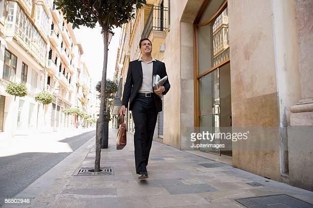 Businessman walking on sidewalk