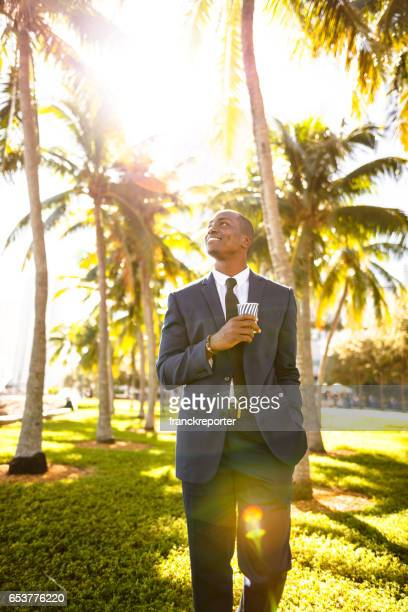 businessman walking on the beach in Miami