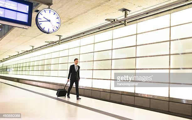 businessman walking on the train station