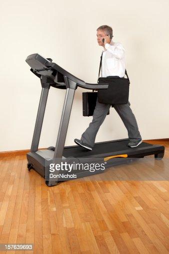 Businessman Walking on Treadmill