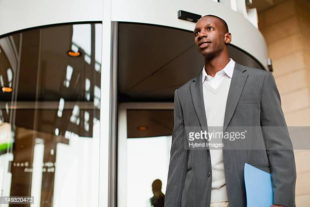 Businessman walking outside building