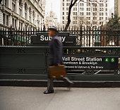Businessman Walking Past Subway Station