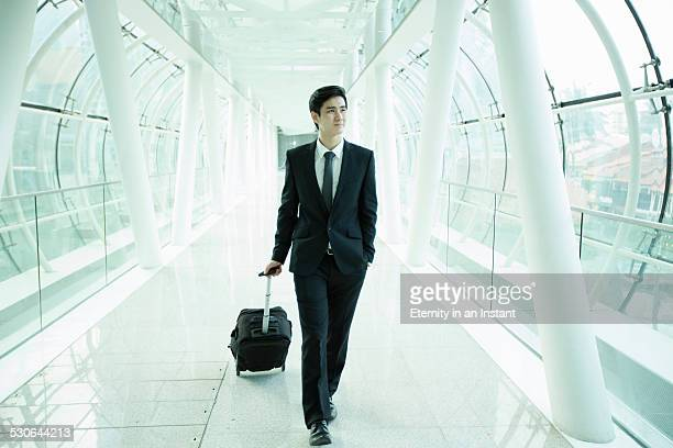 Businessman walking through a glass tunnel