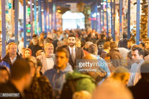 Businessman walking through bazaar
