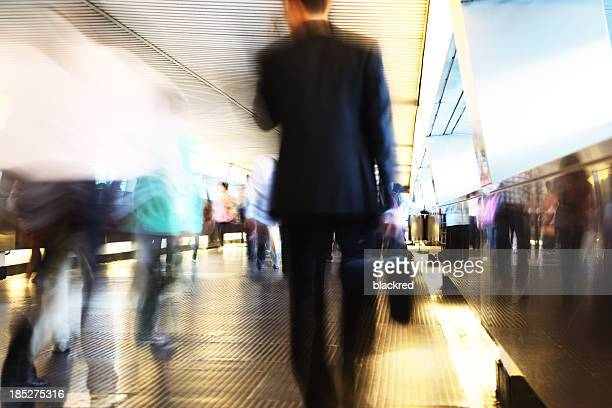 Businessman Walking Through Pedestrian Walkway