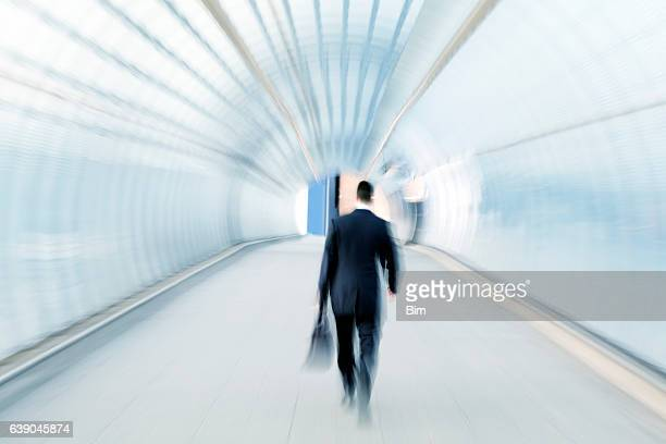 Businessman Walking Through Tunnel