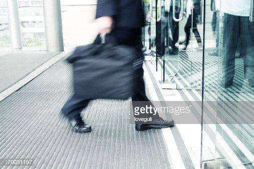 businessman walking to office