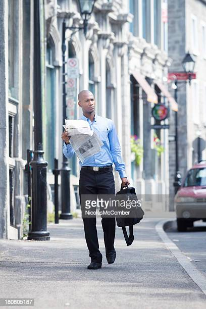 Businessman walking to work in Old Montreal