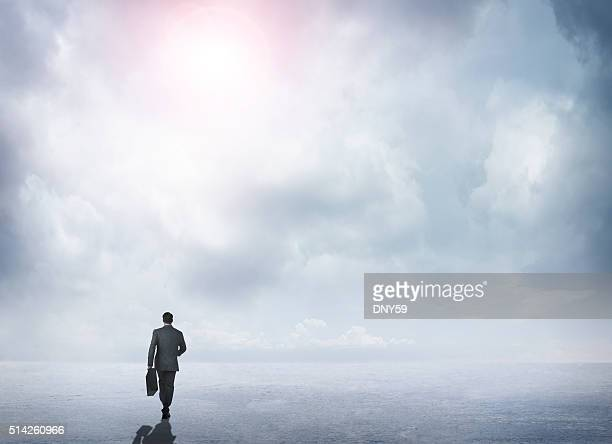 Businessman  Walking Toward The Horizon In A Remote Scene