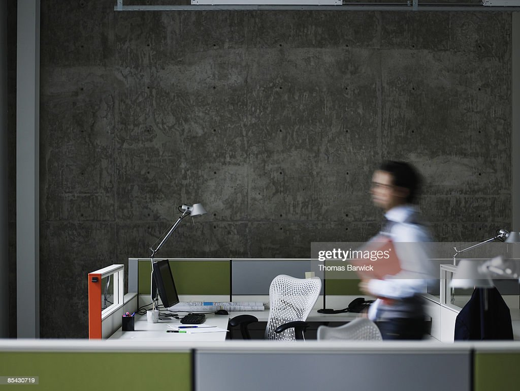 Businessman walking with documents : Stock Photo