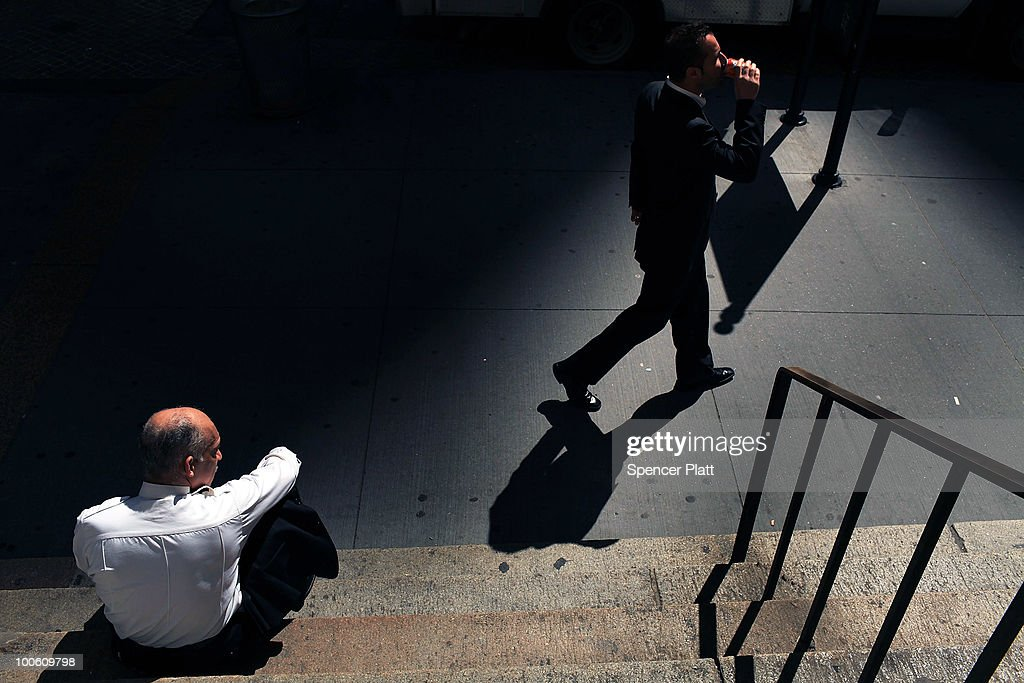 A businessman walks along Wall Street in front of the New York Stock Exchange on May 25, 2010 in New York City. After significant morning losses, the Dow Jones industrial average climbed back in trading to finish down 67 points, or 0.6% for the day. Fears of the continuing European debt crisis and of escalating tension between North and South Korea helped to bring stocks lower.