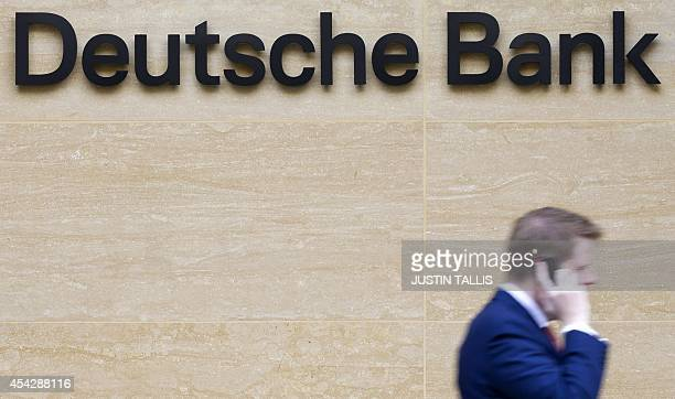A businessman walks an office of Deutsche Bank in London on August 28 2014 The German lender Deutsche Bank has been fined more than 47 million GBP...
