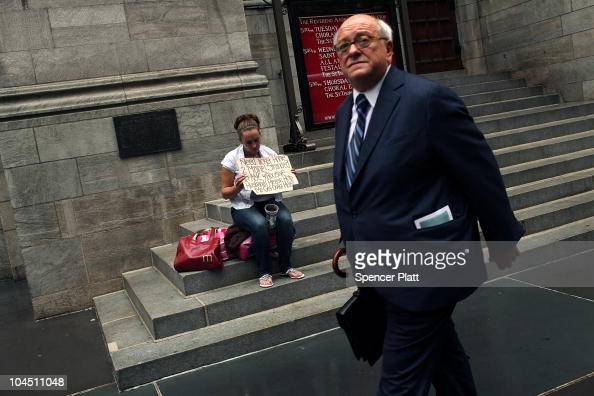 A businessman walks by a homeless woman holding a card requesting money on September 28 2010 in New York City A new report released by the US Census...