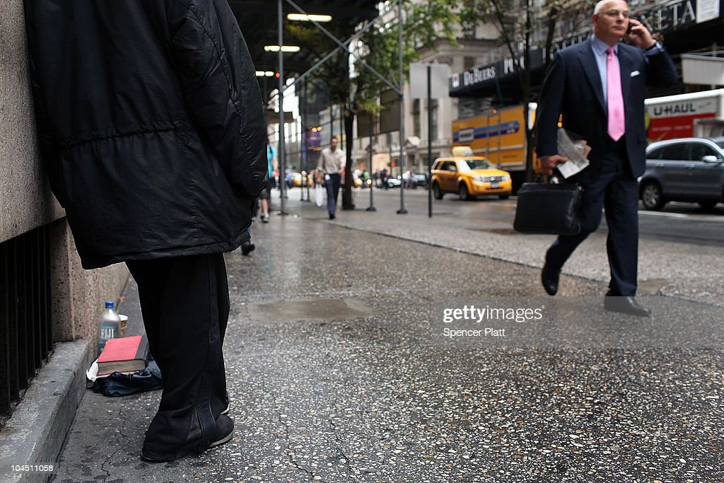 A businessman walks by a homeless woman holding a card requesting money on September 28, 2010 in New York City. A new report released by the U.S. Census Data shows that the income gap between Americans is greater than at any other time on record. The report found that the top-earning 20% of Americans received 49.4% of the country's total income. Conversely, those living below the poverty line earned 3.4% of the national income. This is the highest disparity of wealth among all Western industrialized nations.