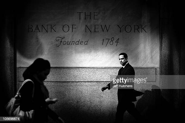 A businessman walks by the Bank of New York in Midtown Mahattan home to many of the world's banks on April 9 2009 in New York City