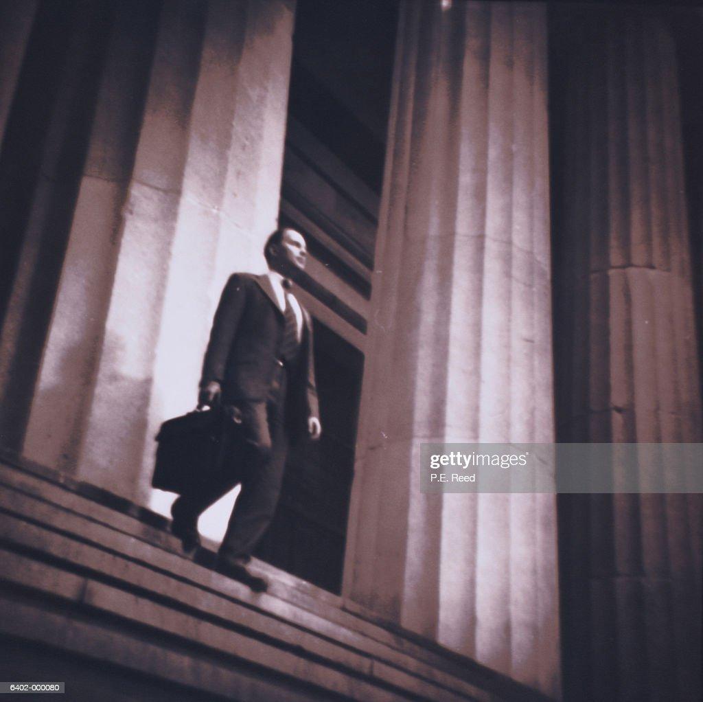 Businessman Walks Down Steps : Stock Photo