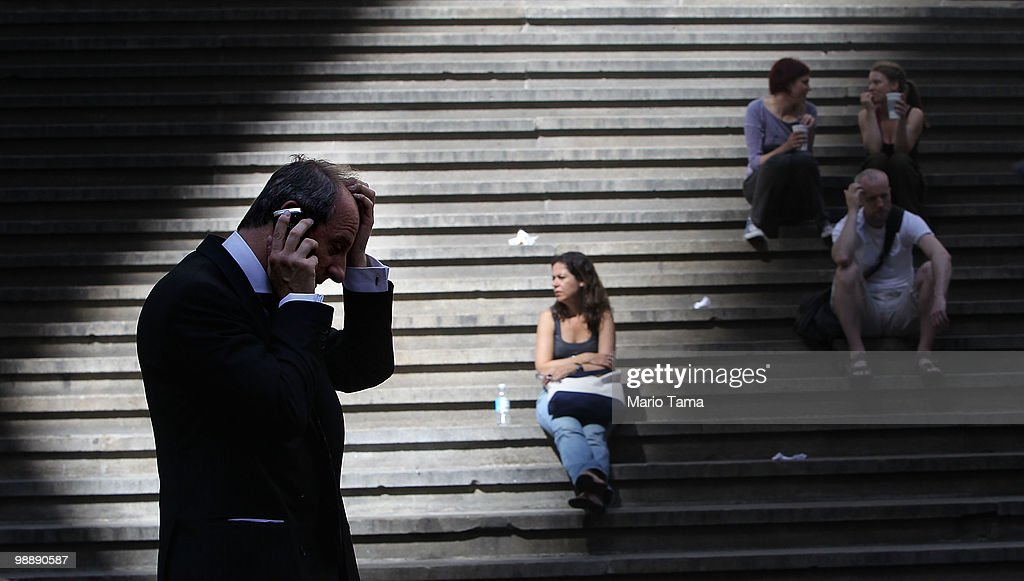 A businessman walks down Wall Street outside the New York Stock Exchange before the closing bell May 6, 2010 in New York City. The Dow plunged almost 1000 points before closing down about 350 on Greek debt fears.