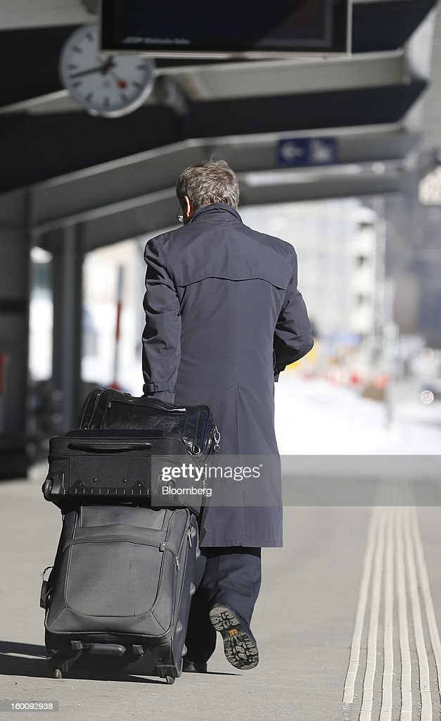 A businessman walks onto the platform at Davos Dorf railway station on the final day of the World Economic Forum (WEF) in Davos, Switzerland, on Saturday, Jan. 26, 2013. World leaders, influential executives, bankers and policy makers attend the 43rd annual meeting of the World Economic Forum in Davos, the five day event runs from Jan. 23-27. Photographer: Simon Dawson/Bloomberg via Getty Images
