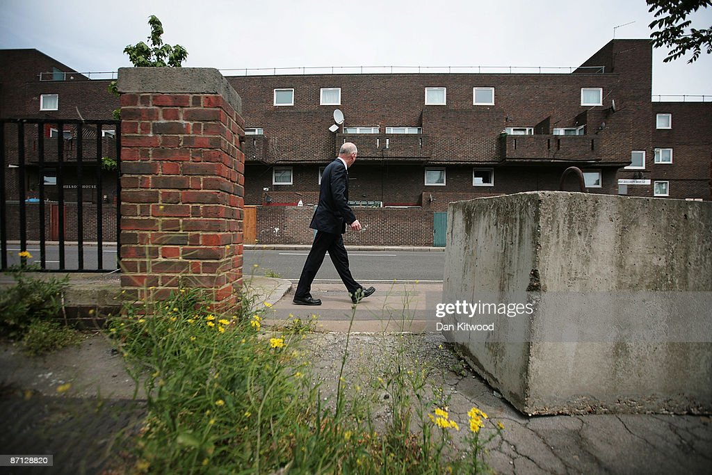 A businessman walks past a council estate in an area of South London within a few miles of Parliament, more affluent pockets of the neighbourhood are popular with MPs as a location for their second homes due to the proximity of the seat of power on May 12, 2009 in London, England. MPs have come under increasing pressure over revelations concerning their household expenses and second home allowances. Whilst the country at large experiences the effects of a deep recession there is growing unease over an apparent manipulation of a system designed to recompense MPs for costs incurred in serving their constituents.