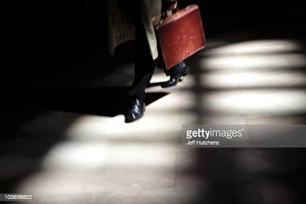 A businessman walks through a spot of light on the floor of Grand Central Station in Midtown Manhattan home to many of the world's banks on April 9...