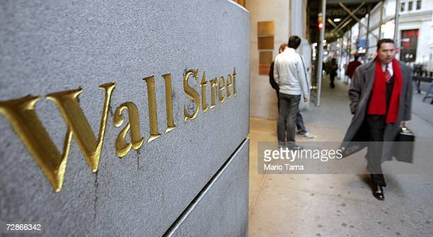 A businessman walks up Wall Street in the financial district December 21 2006 in New York City Wall Street's top financial firms' soaring profits...