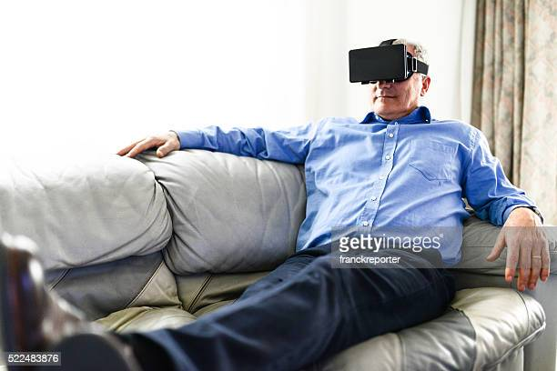 businessman watching a movie on the couch