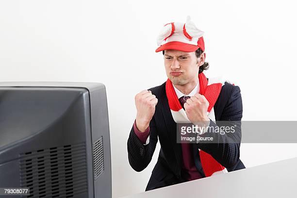 Businessman watching football