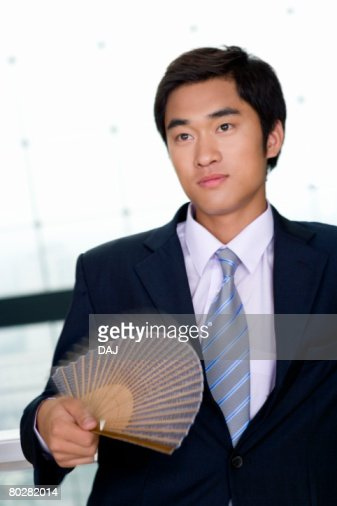 Businessman Waving Japanese Fan, Blurred Motion, China, Beijing : Foto de stock