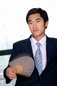 Businessman Waving Japanese Fan, Blurred Motion, China, Beijing