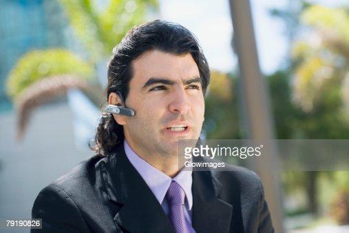 Businessman wearing a hands free device : Foto de stock