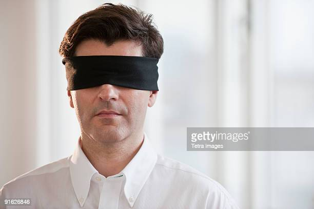 Businessman wearing blindfold