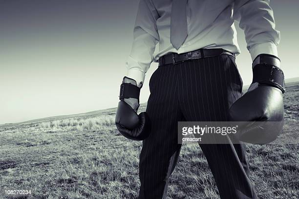 Businessman Wearing Boxing Gloves on Hill, Sepia Toned