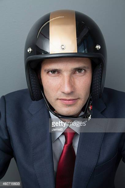 Businessman wearing crash helmet