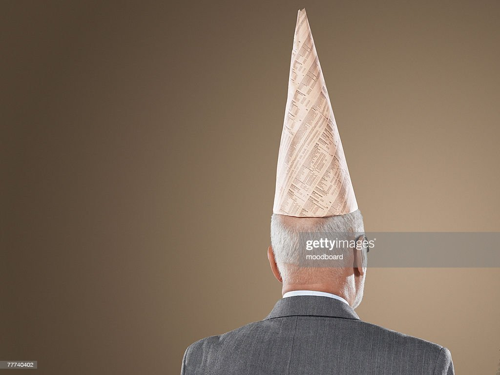 Businessman Wearing Dunce Cap : Stock Photo