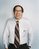 Businessman wearing glasses, laughing