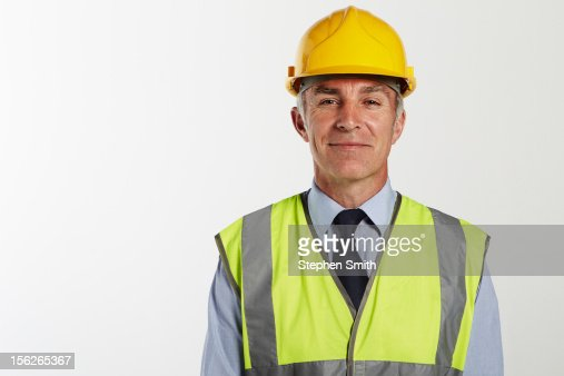Businessman wearing hard hat and high vis jacket : Foto de stock