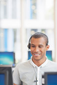 Businessman wearing headset in office