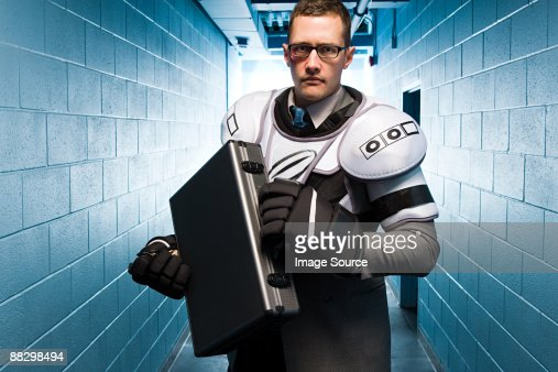 Businessman wearing ice hockey pads