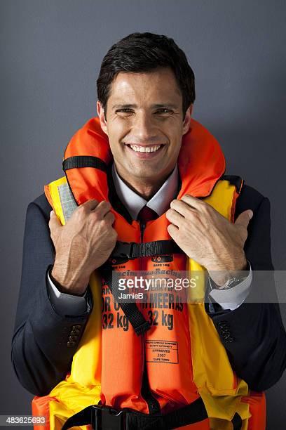 Businessman wearing life jacket