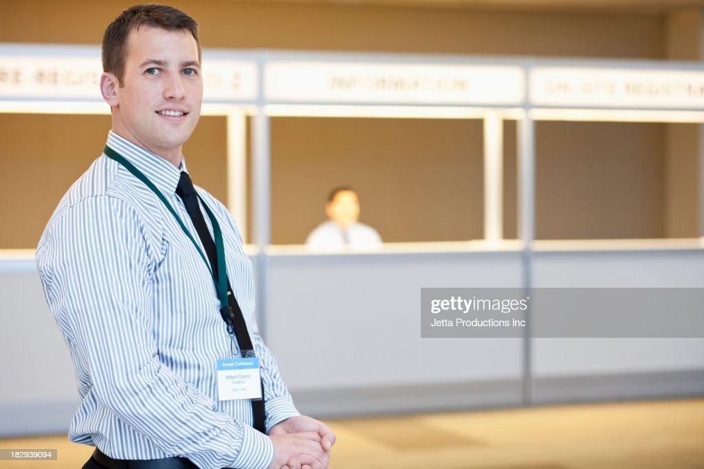 Businessman wearing name tag