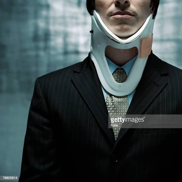 Businessman Wearing Neck Brace