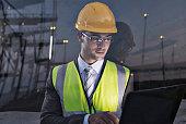 Businessman wearing protective workwear near window