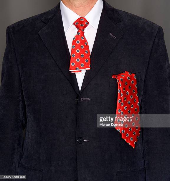 Businessman wearing severed tie, mid section