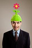 Businessman wearing silly flower hat