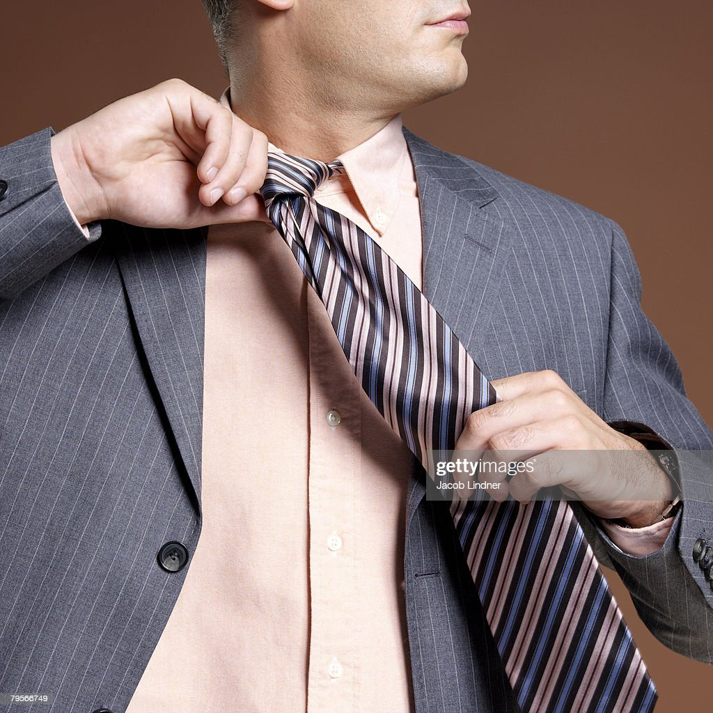 'Businessman wearing suit and tie, close-up' : Stock Photo
