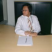 Businessman wearing telephone headset