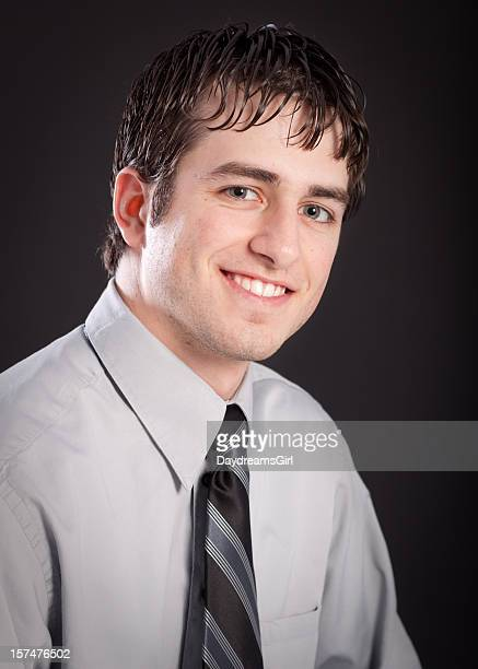 Businessman Wearing Tie Studio Head Shot Black Background