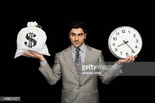Businessman weighing time versus money