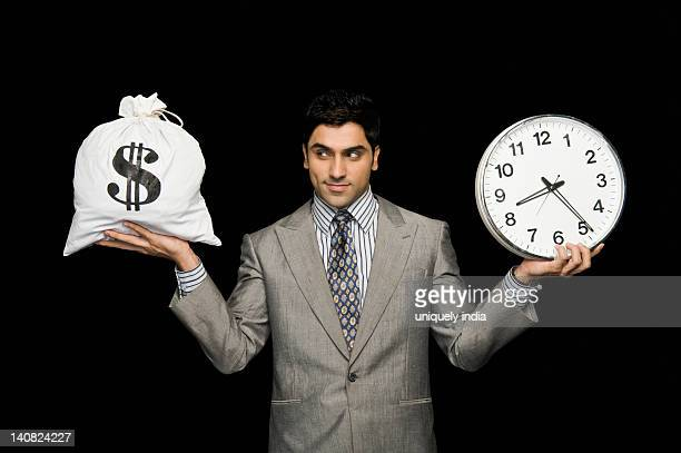 Businessman weighing time versus money
