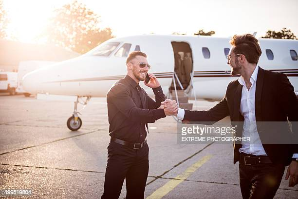 Businessman welcoming his partner at the airport